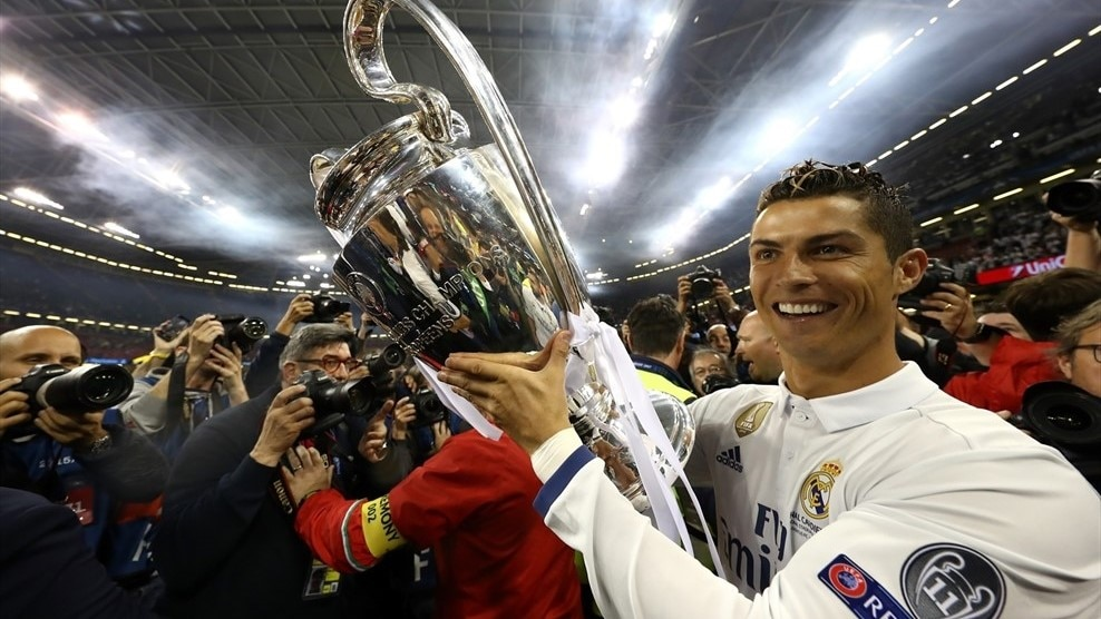 Cristiano Ronaldo shows off the trophy he has won for a fourth time