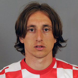Luka Modric with his long hair parted in the middle with a hanging hairstyle for the Euro 2012